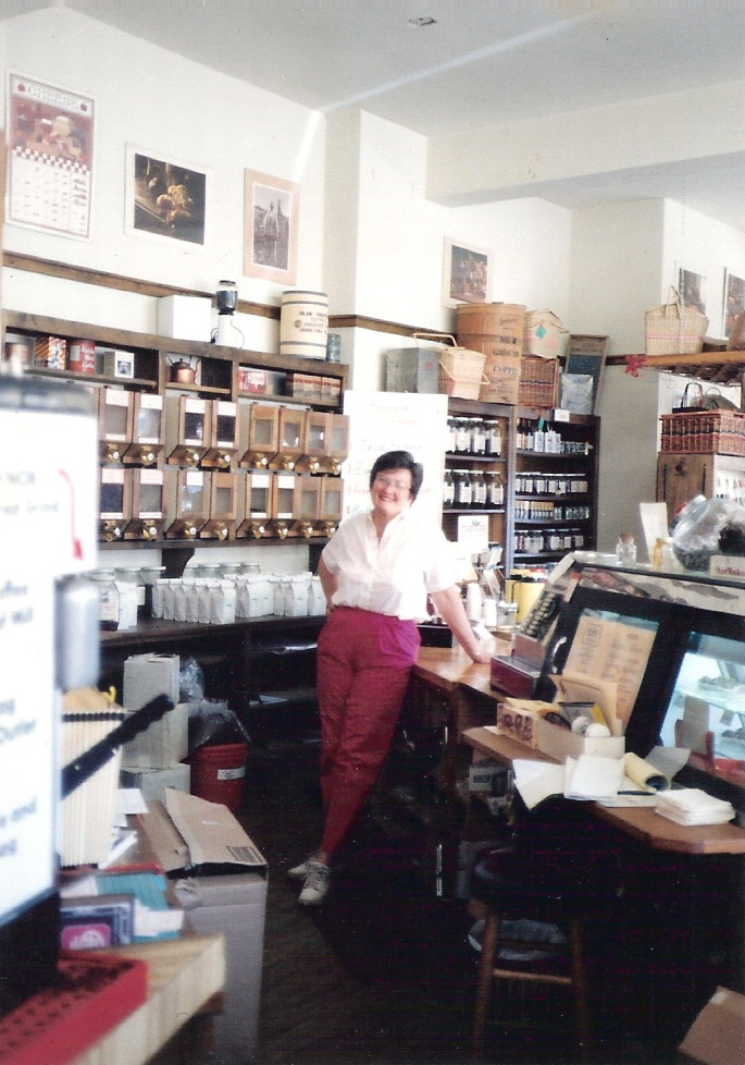 Caroline behind counter